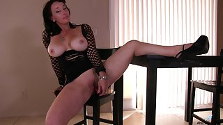 Busty full-grown Sugar Sweet opens her legs to play with a fake dick