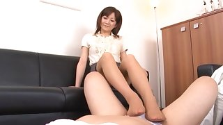 Asian chick gives a footjob and drops on her knees to blow