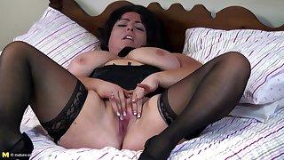 Big busty lady rubs her clit