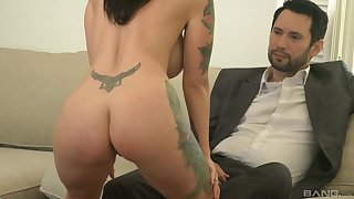 tattooed milf Dolly Darko is ready for hard sex with her join up on the couch