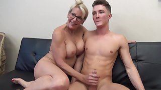 Full-grown light-haired female with glasses is fumbling her step- sonny's man meat after railing it a pile