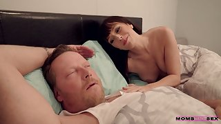 Sex-starved milf Alana Cruise is masturbating pussy in front of asleep husband