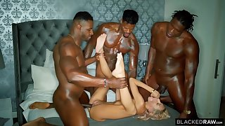 Three horny hyacinthine guys are stretching one poor blonde cutie with their immutable throbbing cocks